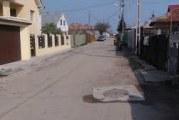 Locuitorii de pe 18 strazi din Craiova la un pas de o mare realizare: vor vedea asfalt pe strazile unde locuiesc!